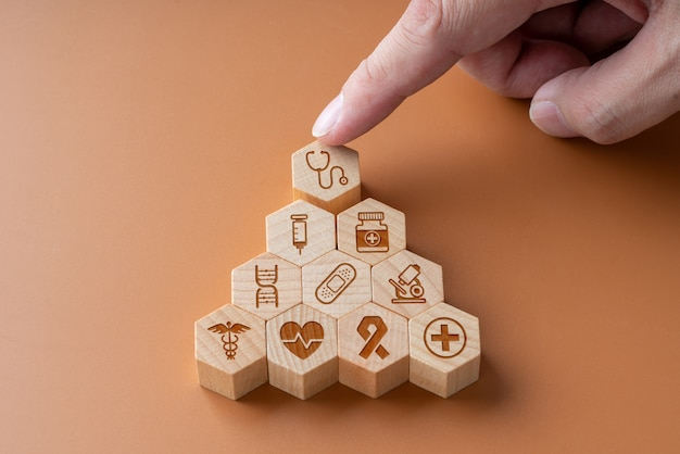 Medical icon on hexagon jigsaw for global health care