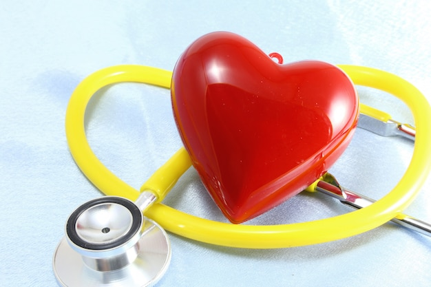 Medical instruments, stethoscope and red heart