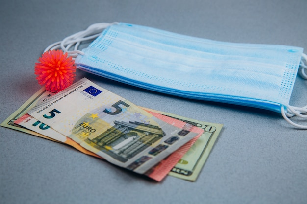 Medical mask, abstract virus model and money