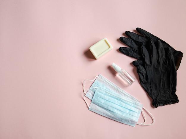 Medical masks, bottle sanitizer, piece soap and black disposable gloves