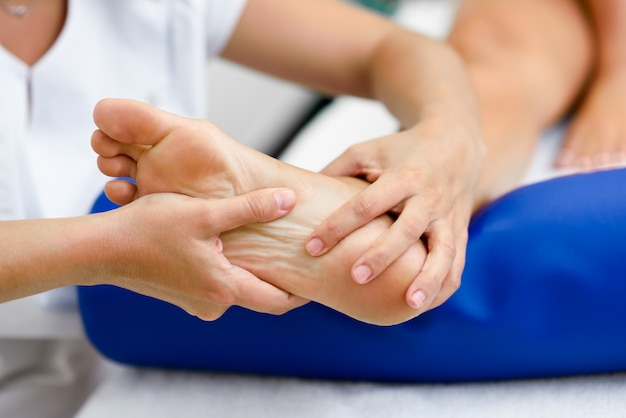 Medical massage at the foot in a physiotherapy center.
