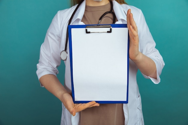 Medical news. woman holding tablet in the blue cabinet.