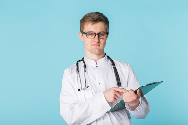 Medical physician doctor man over blue clinic background.