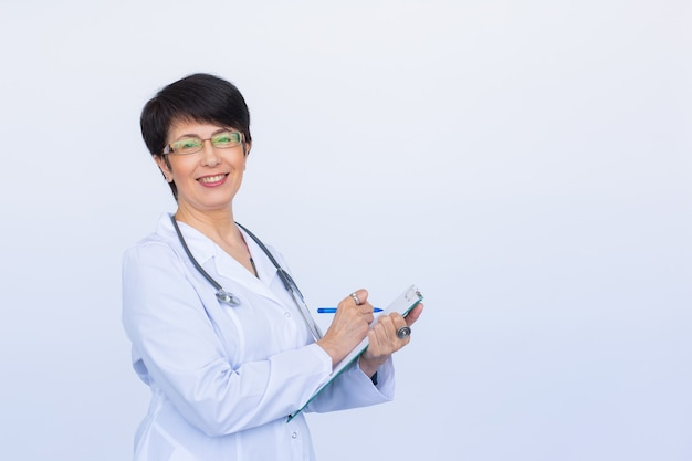 Medical physician doctor woman over white background with copy space