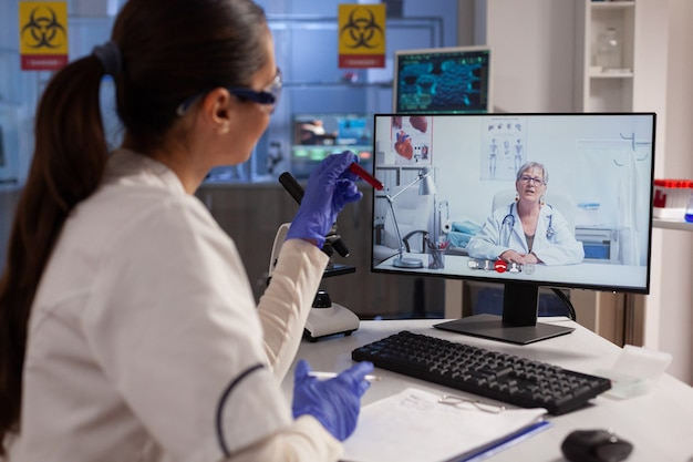 Medical researcher doing video call conference with expert