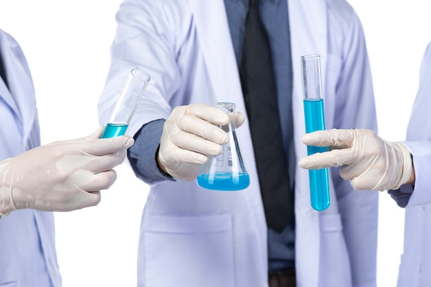 Medical researchers and in vitro chemicals, isolated on white