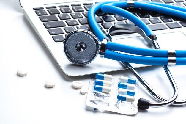 Medical stethoscope on computer keyboard