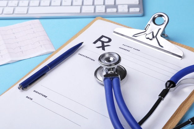 Medical stethoscope lying on cardiogram chart closeup. medical help, prophylaxis, disease prevention or insurance concept. cardiology care.