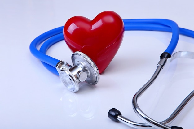 Medical stethoscope and red heart isolated