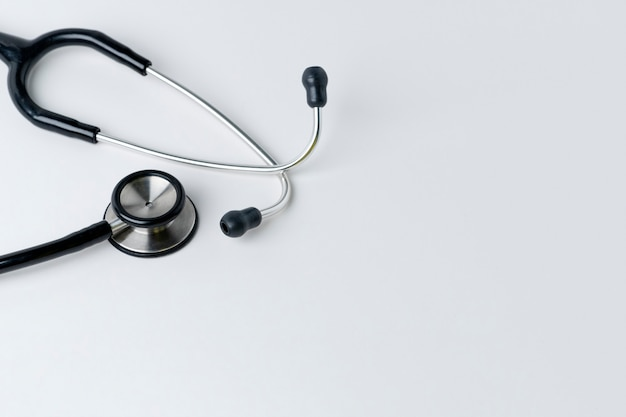 Medical stethoscope on a white