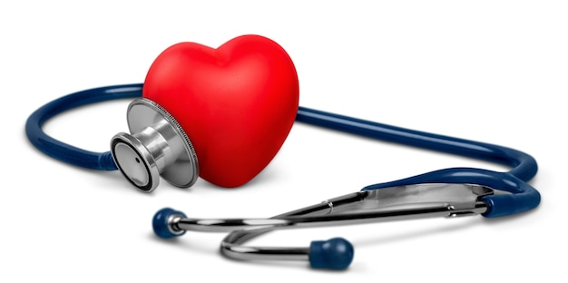 Medical stethoscope with plastic heart isolated on white