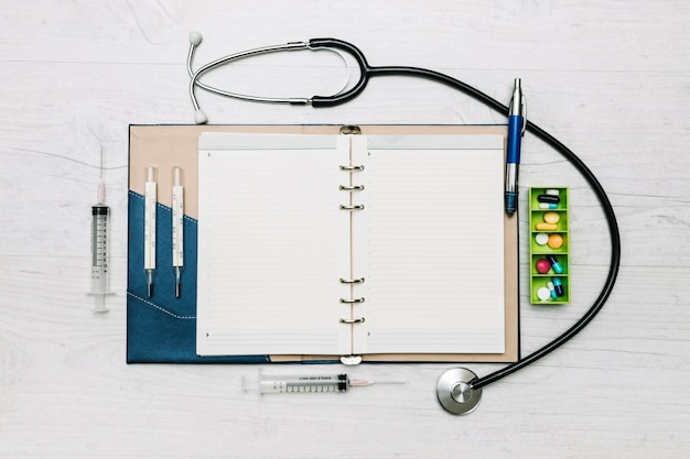 Medical supplies around notepad