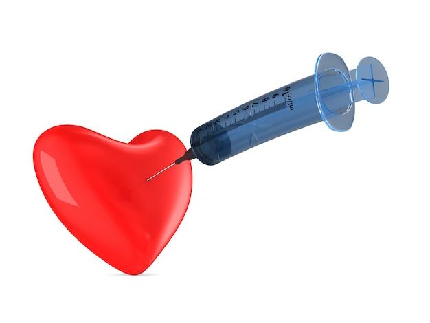 白の医療注射器と心臓