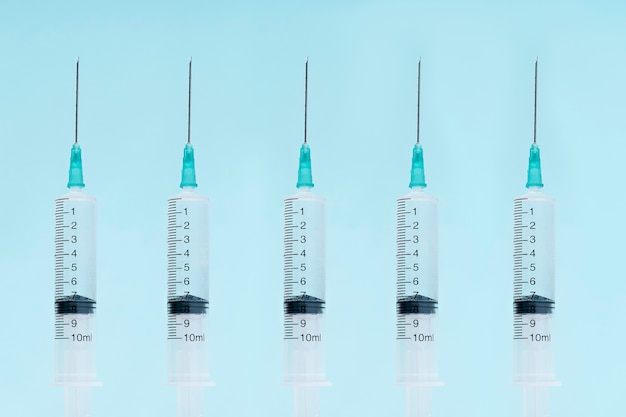 Medical syringes for the introduction of medicines. device for vaccinating patients. five syringes close up