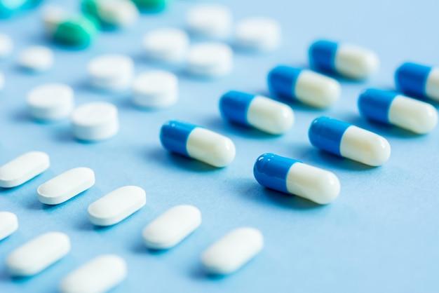 Medical tablets on light blue background