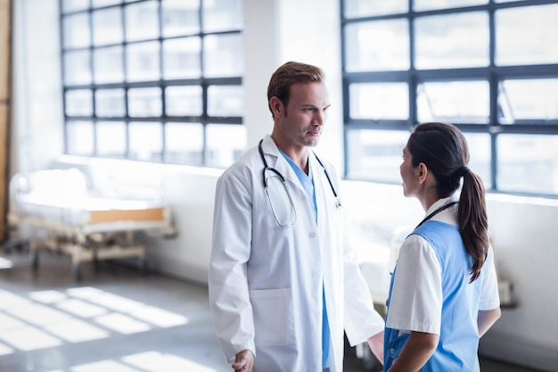 Medical team discussing together in the hallway