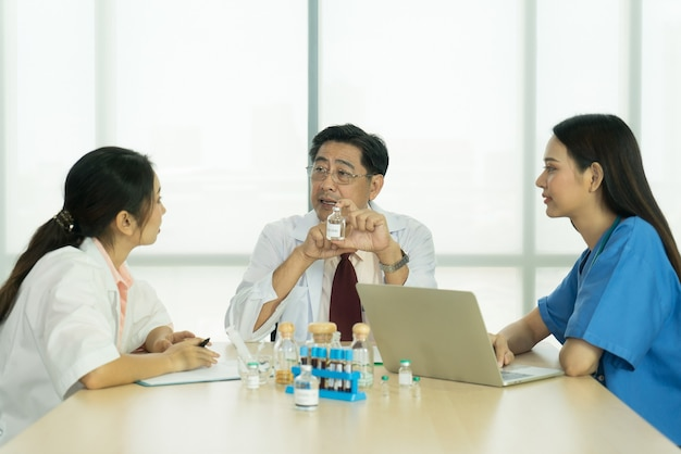 The medical team meeting together to find treatment options in the meeting room