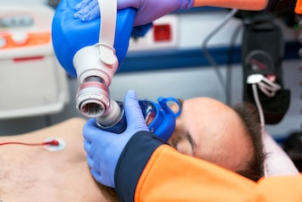 Medical urgency in the ambulance. Cardiopulmonary resuscitation using hand valve mask bag