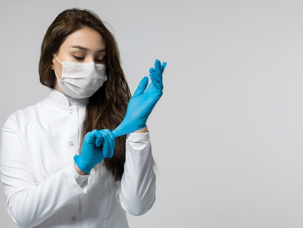 Medical worker wearing blue gloves