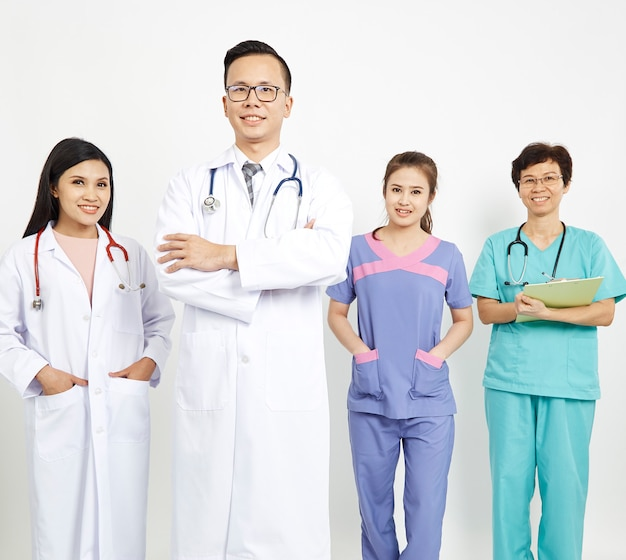 Medical workers on wall background