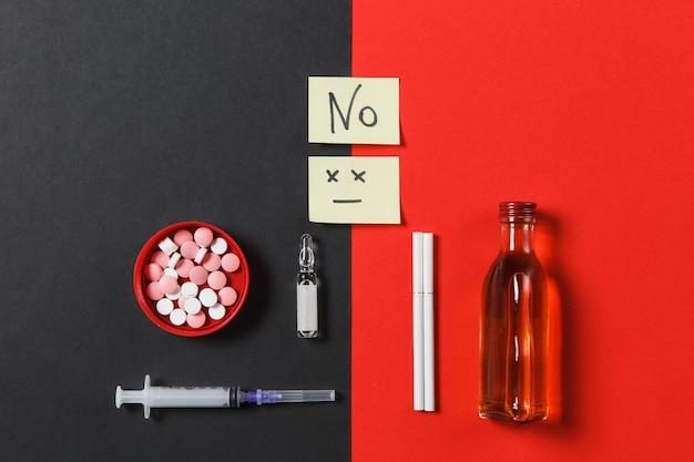 Medication colorful round tablets pills empty syringe needle, bottle alcohol ampoule cigarettes