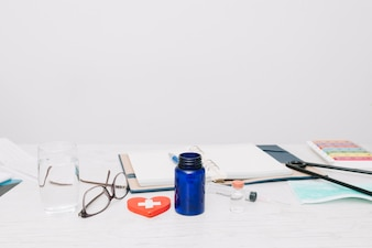 Medications and notebook on table