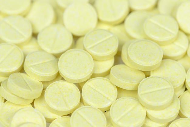 黄色い丸薬の医学の背景