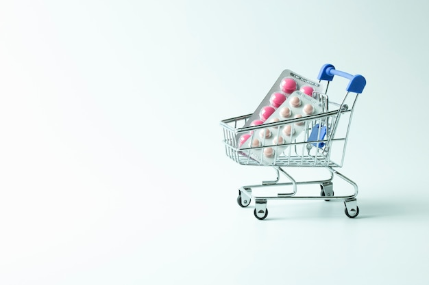 Medicine blister in trolly cart isolated on white background