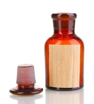 白の空白のラベルが付いている薬瓶