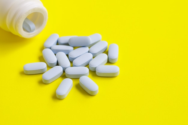 Medicine bottle with blue pills