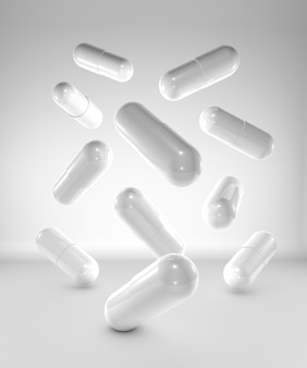 Medicine capsules on white background