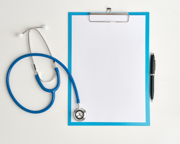 Medicine concept of stethoscope and clibboard, top view closeup