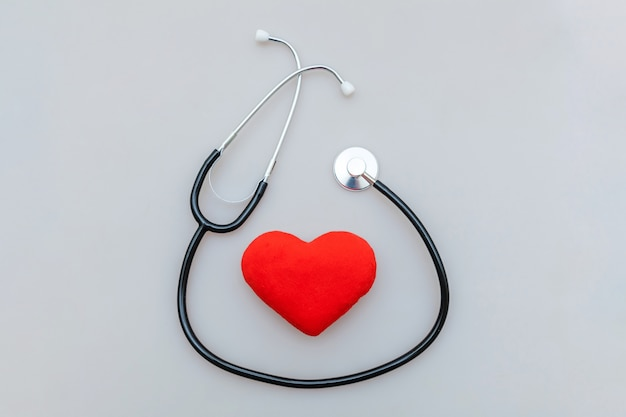 Medicine equipment stethoscope and red heart isolated on white background