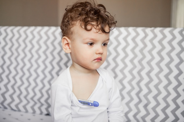 The medicine. flu virus. baby measures temperature