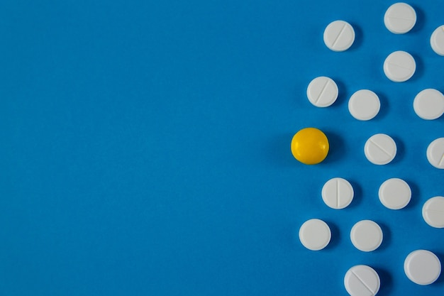 Medicine and health pills on blue background from above