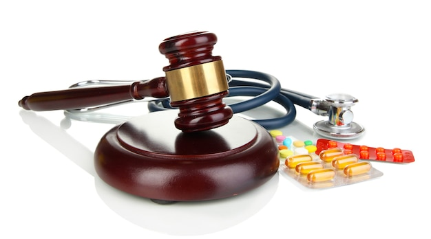 Medicine law concept. gavel, stethoscope and pills isolated on white