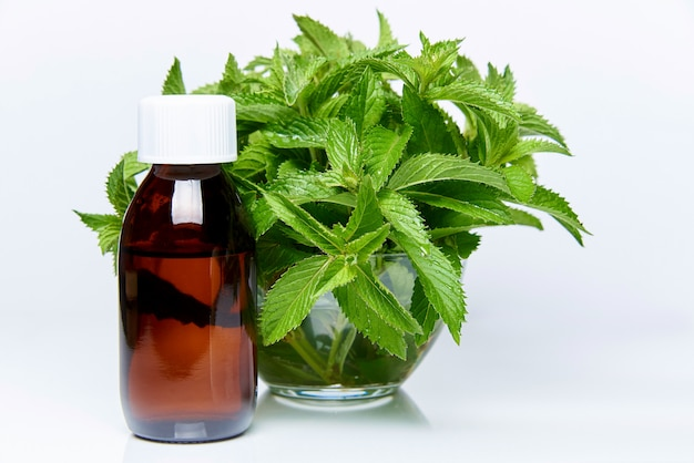 Medicine and mint on a white background.