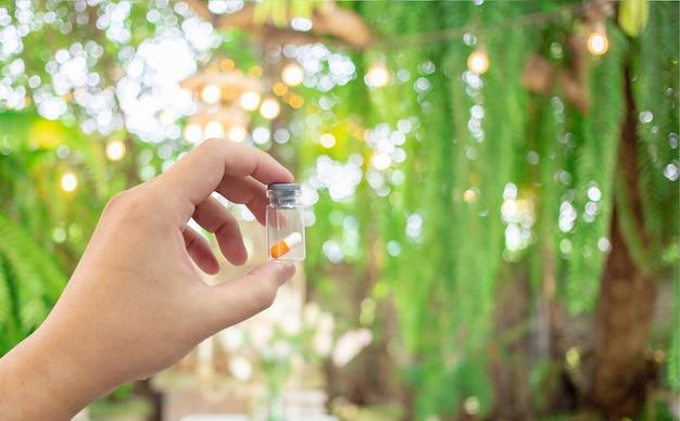 Medicine pill in bottle with blur scientist lab