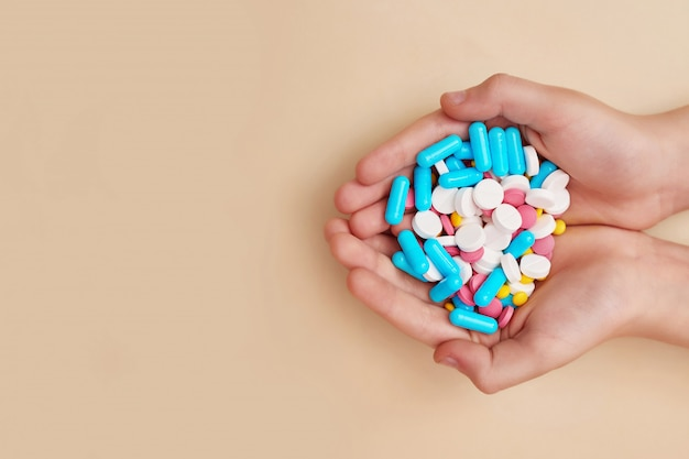 Medicine pills or capsules in hand. medicine concept and health.