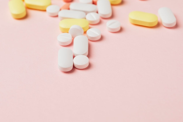 Medicine and pills on a pink background
