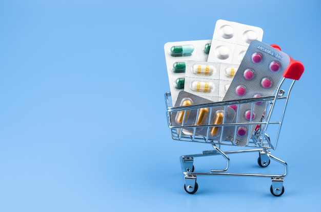Medicine, supplements in trolley, delivery online concept