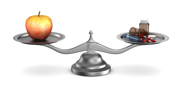 Medicines and apple on scales