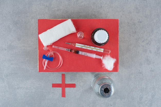Medicines with syringe on gray