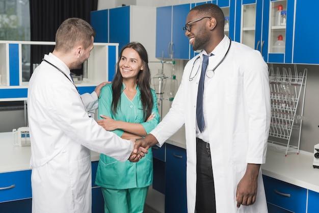 Medics handshaking in hospital