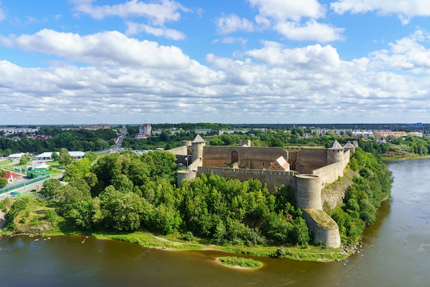 Medieval castle on the border of russia and estonia by the river.