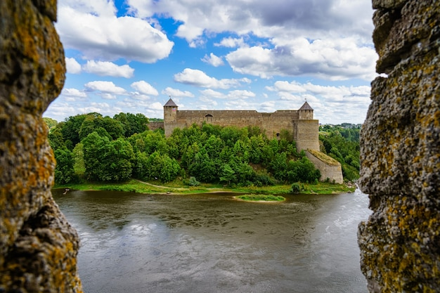 Medieval castle next to the mouth of the river on the border of russia and estonia.