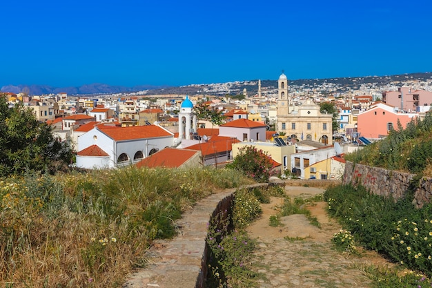 The medieval city with orthodox cathedral trimartiry, aerial view from schiavo bastion in the sunny morning, crete, greece