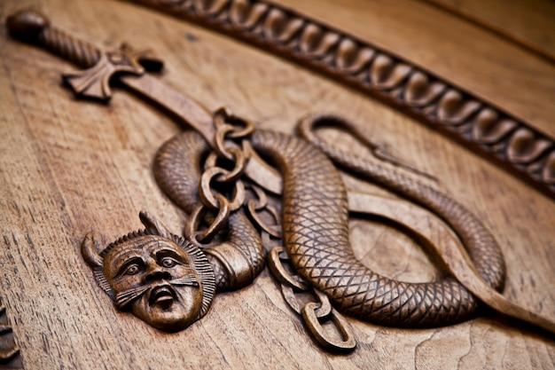 Medieval demon on antique door- sacra di san michele (st. michael abbey) - torino - italy