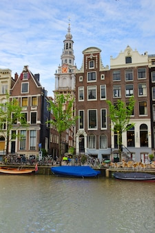 Medieval houses on canal in amsterdam, netherlands