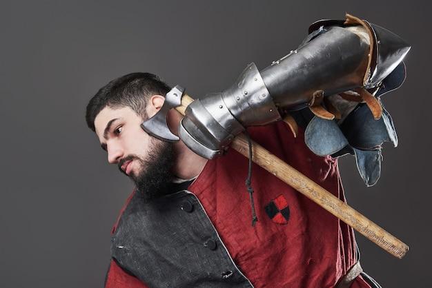 Medieval knight on grey